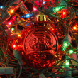 Red christmas ball in christmas lights — Stock Photo