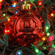 Red christmas ball in christmas lights — Stock Photo #8820247