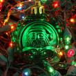 Green christmas ball in christmas lights — Stock Photo