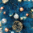 Background of christmas ornaments on tree — Stock Photo