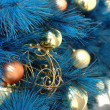 Christmas ornaments on tree — Stock Photo