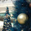 Golden christmas ball on tree — Stock Photo