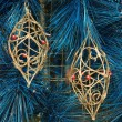 Golden ornaments on blue christmas tree — Stock Photo