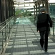 Businessman walking on modern bridge — Stock Photo