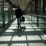 Businessman walking on modern bridge — Stock Photo