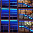 Office building in blue lighting — Stock Photo