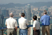 Four gentlemen looking at the commerical city — Stock Photo
