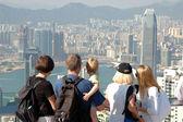 Famly sightseeing the Hong Kong skyline — Stock Photo