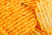 Spicy potato chips background — Stock Photo