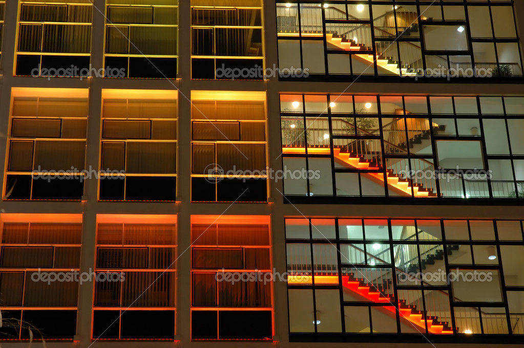 Exterior of an office building in orange lighting — Stock Photo #8820786