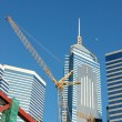 Stock Photo: Crane and business buildings