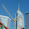 Crane and business buildings — Stock Photo