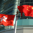 China and Hong Kong flags - Stock Photo