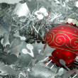 Christmas ball over silver garland — Stock Photo #8872624