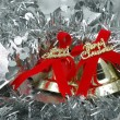 Foto Stock: Christmas bells over silver garland