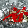 Stock Photo: Christmas bells over silver garland