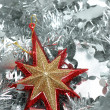 Christmas star over silver garland — Stock Photo