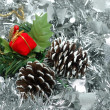 Stock Photo: Christmas ornaments over silver garland