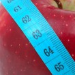 Red apple with measuring tape — Stock Photo #8872694
