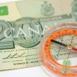 Compass on canada dollar bill — Stock Photo