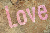 Love on stone background — Stock Photo