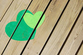 Hearts on wooden floor — Stock Photo