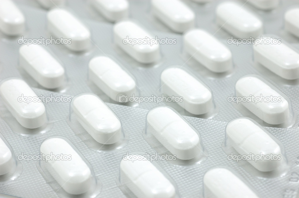 Background of white headache pills in blisters — Stock Photo #8872665