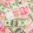 Stock Photo: US dollar and Chinyubackground