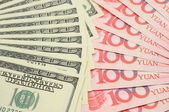Fanned US dollar and China yuan — Stock Photo