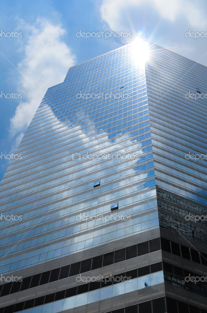Blue sky with cloud and sun reflection on skyscraper  Stock Photo #9146211