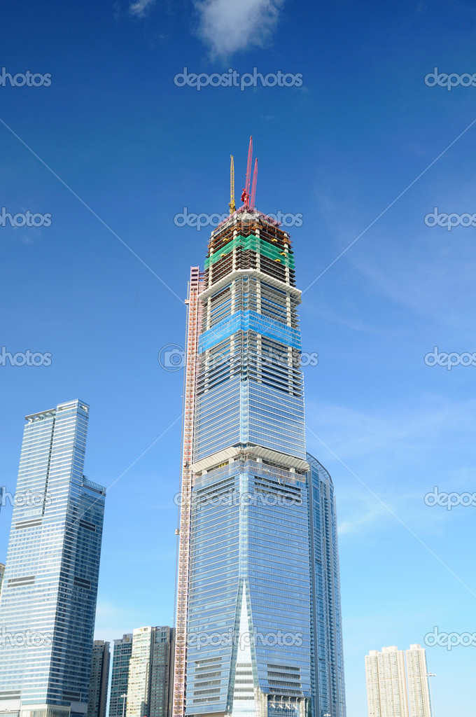 Highrise building in construction over blue sky  Stock Photo #9147264