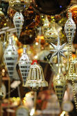Christmas bell and ornaments — Stock Photo