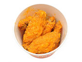 Bucket of hot wings — Stock Photo