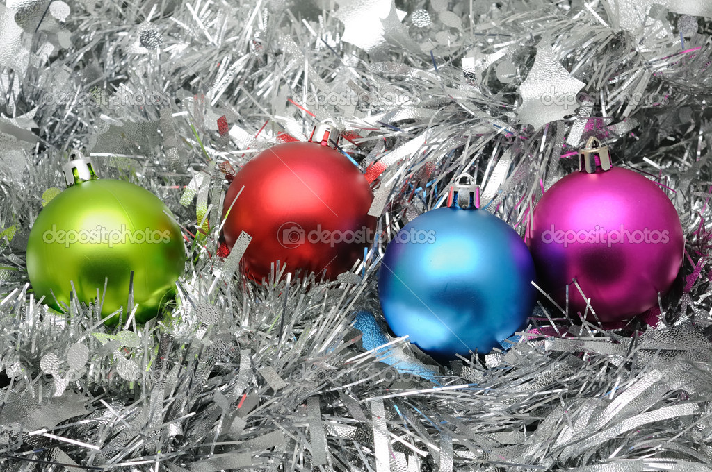 Colorful christmas balls in silver garland background — Stock Photo #9476092