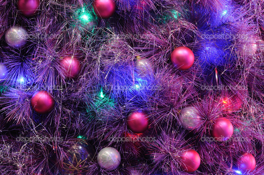Christmas ornaments on tree in colorful lighting — Stock Photo #9621417