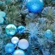 Christmas ornaments on tree — Stock Photo