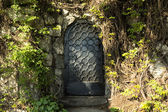 Mysteru door in the forest — Stock Photo