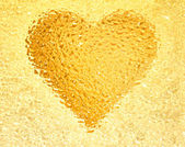 Frozen gold heart — Stock Photo
