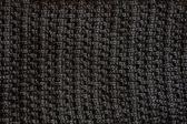 Czarny teksturowanej tkanina tło — Zdjęcie stockowe