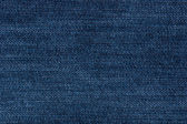 Blue jeans denim fabric texture (horizontal) — Stock Photo