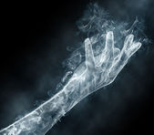 Female hand from a smoke — Stock Photo