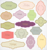 Set of ornate vector frames and labels — Stock Vector