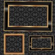 Stock Vector: Empty gold and black frames on the wall