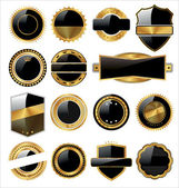 Vector set of black gold labels with place for text. — Stock Vector