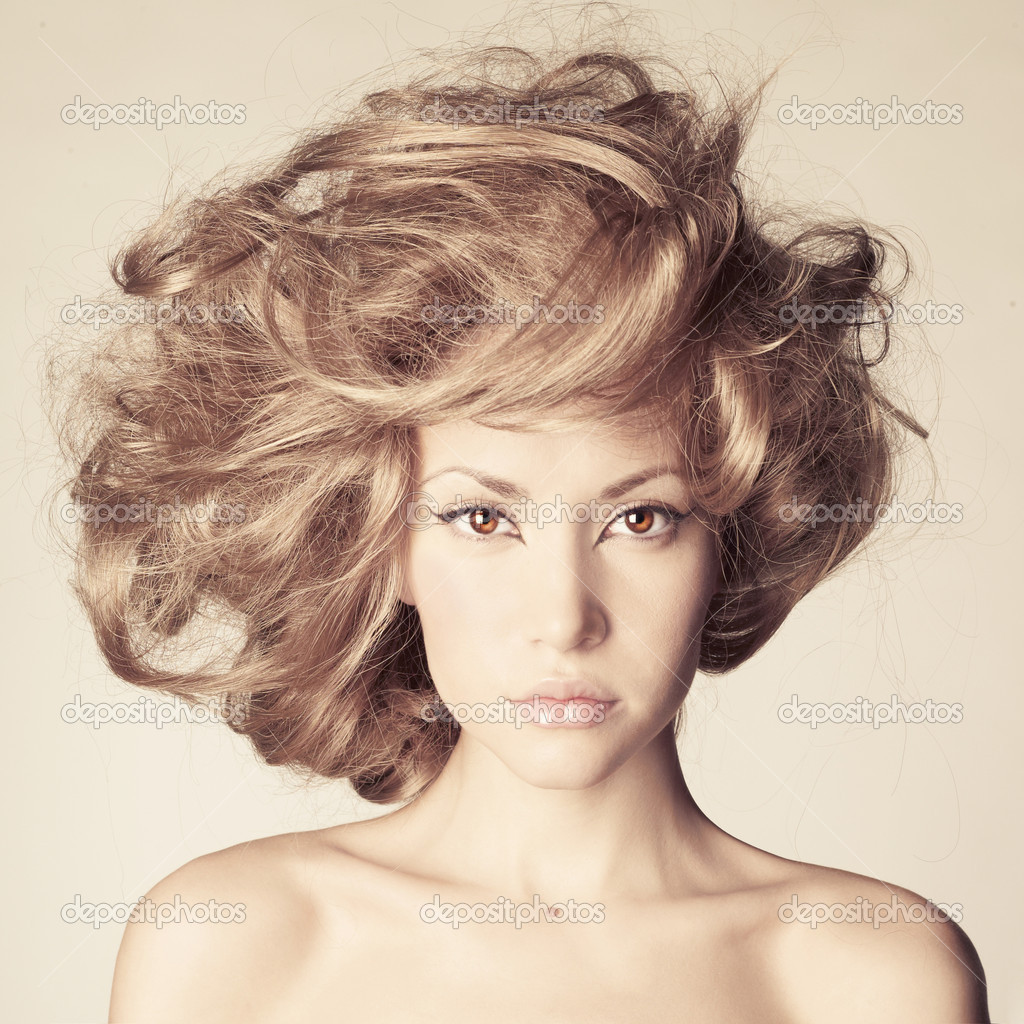 Photo of young beautiful woman with magnificent hair  Stock Photo #8129673