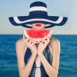Young lady at sea with watermelon — Stock Photo #9701725