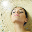 Lady in straw hat - Stock Photo