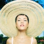 Lady in straw hat — Stock Photo