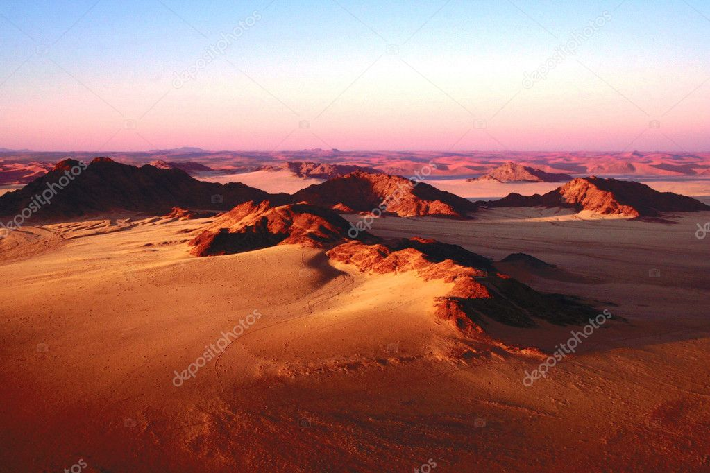 Sossusvlei Namibian desert landscape from balloon with rocks and sand and sunset colors  Stock Photo #9512423