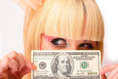 Blond girl with dollar bill — Stock Photo